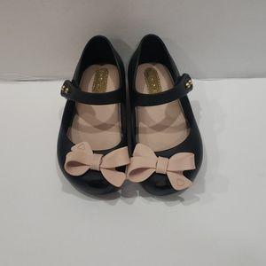 Black and pink Mini Melissa bow flats